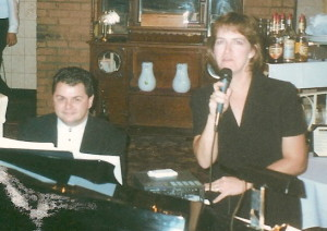 Sue and John performing at Nikos
