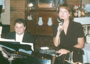 Sue and John performing at Nikos