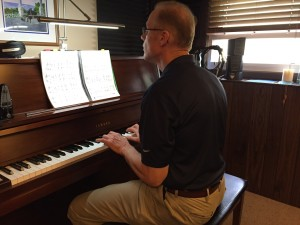 Adult Student in a Piano Lesson